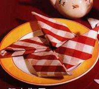 用你的餐巾折叠可爱的风车 餐巾折叠艺术
