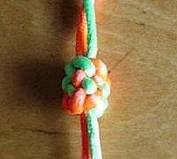 六辫纽扣结的打法 凤梨结的编织方法