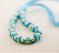 珠子与缎带串起来的小清新手链手工制作图解