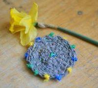 用绳子手工编织圆形杯垫图解教程