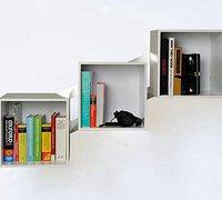 跷跷板和树形的创意墙上书架设计