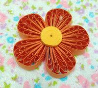 用梳子简单制作衍纸花的方法