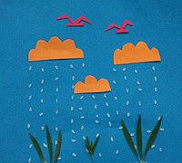 用海绵纸拼贴出下雨天的儿童情景画
