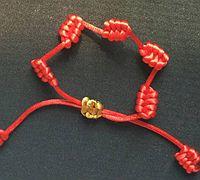 简单的凤尾结红绳手链编法