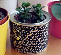 旧铁罐子变费为宝DIY好看的小花盆
