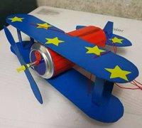 易拉罐和旧纸盒diy小飞机模型